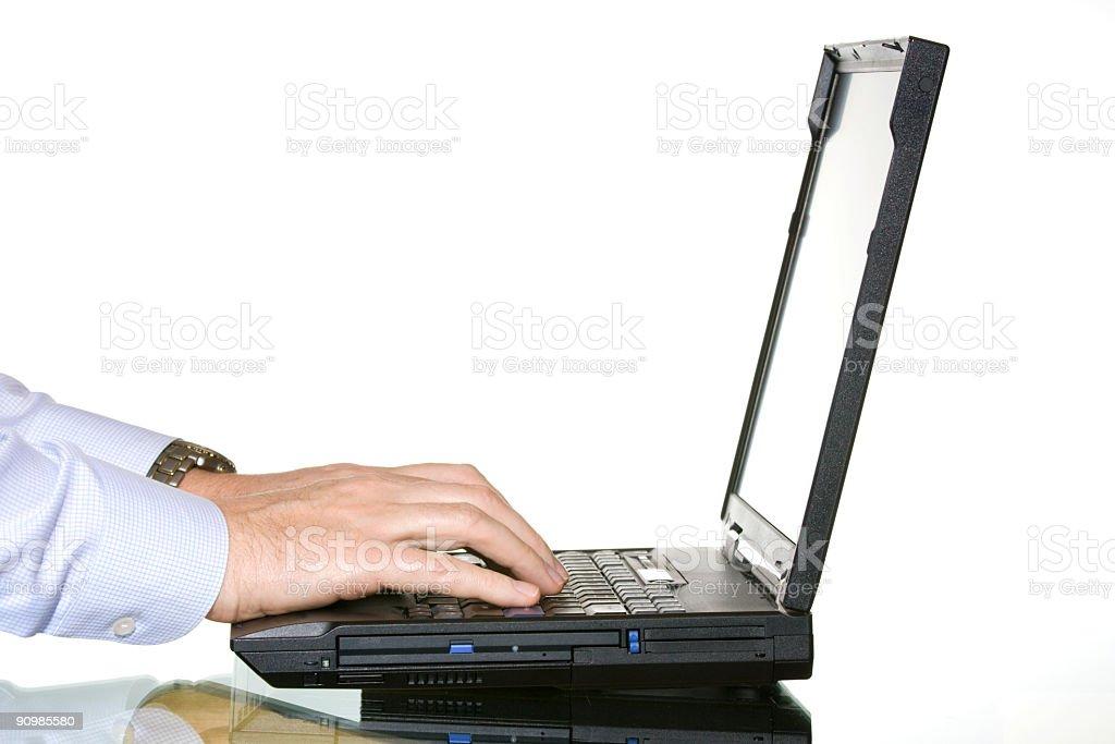 Working on laptop royalty-free stock photo