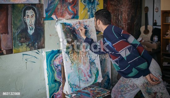 865169666 istock photo Working on painting 863132568