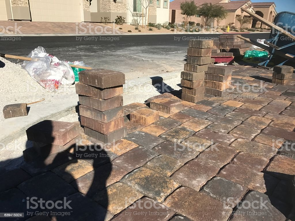 working on pavers stock photo