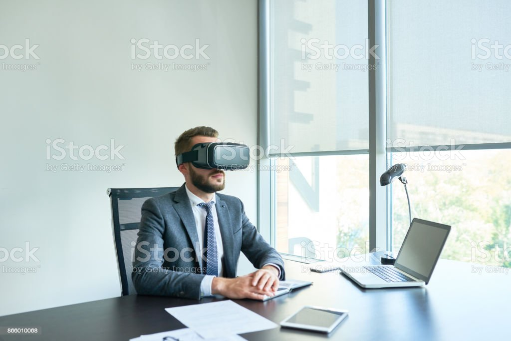 Working on Project with VR Headset stock photo