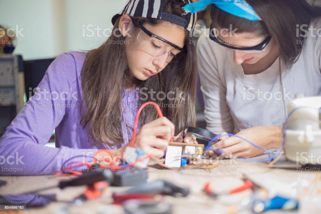 Working on school engineering project stock photo