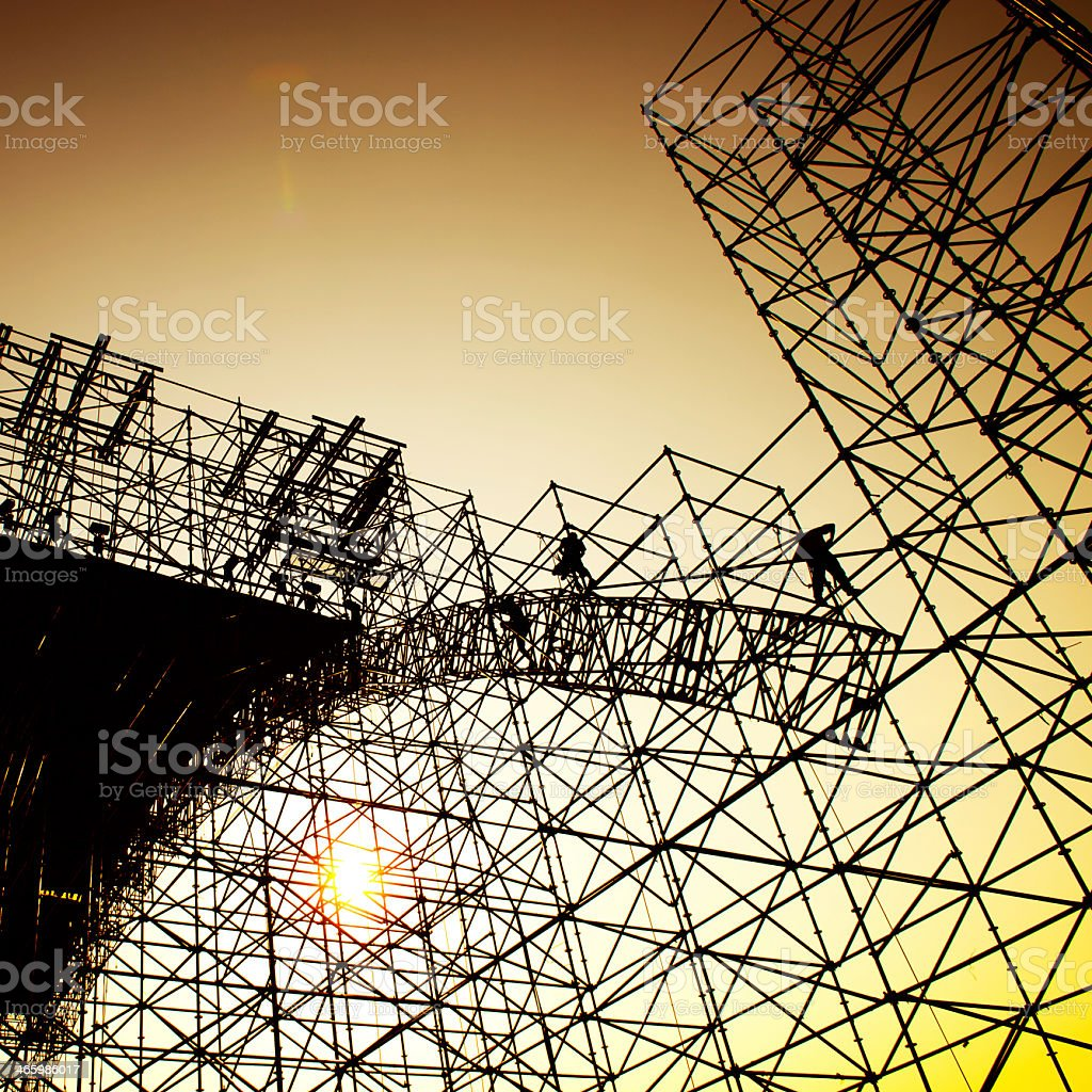 Working on securing scaffolding stock photo