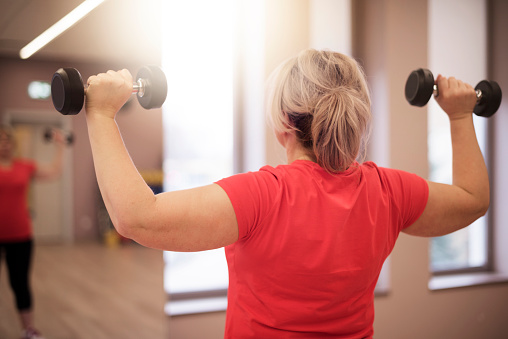 Working On Shoulders In This Age Is Important For Women Stock Photo - Download Image Now