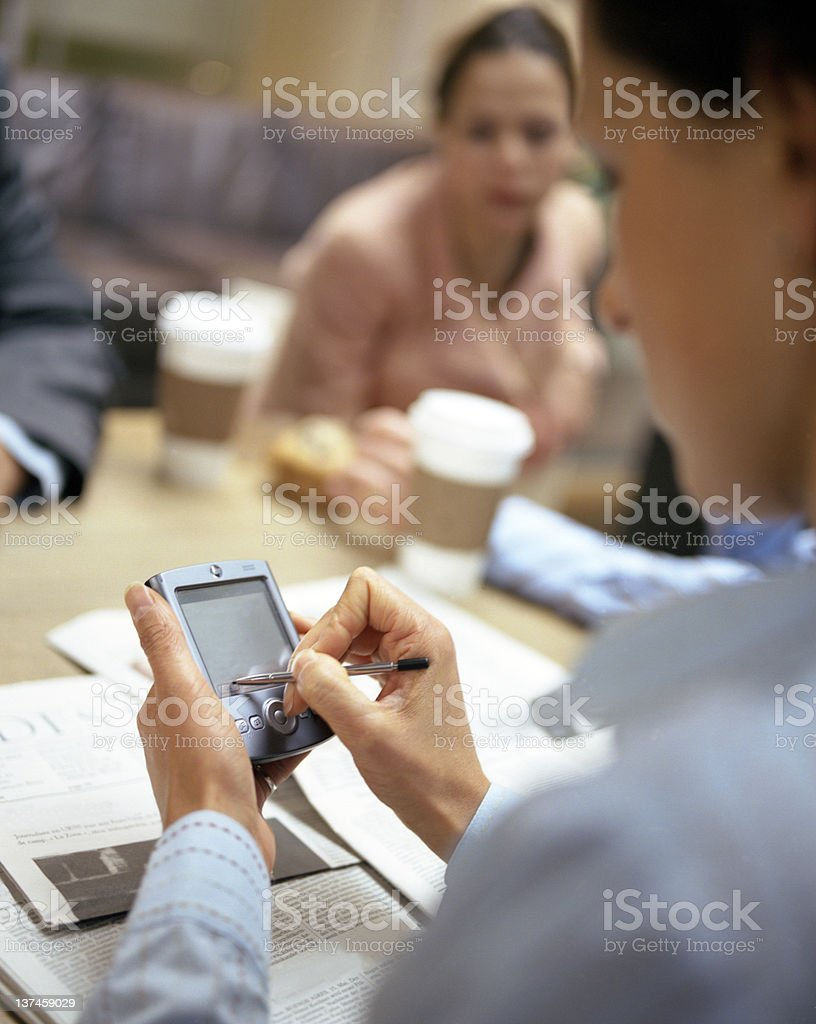 Working on smart phone royalty-free stock photo
