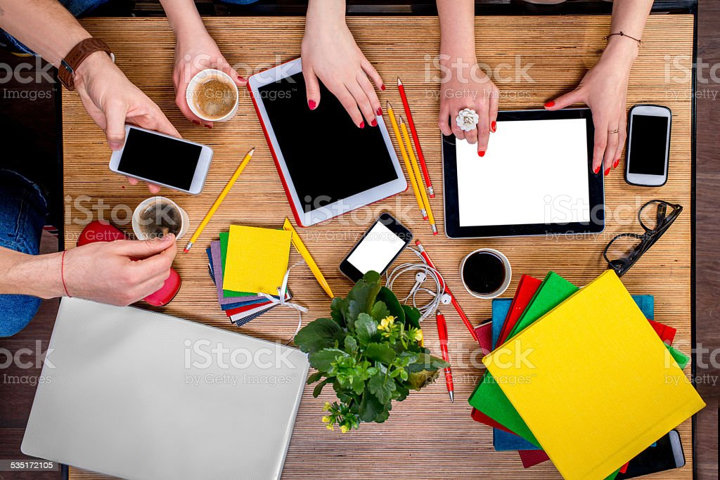 Working on table with gadgets stock photo
