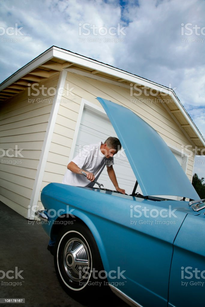 working on the car royalty-free stock photo