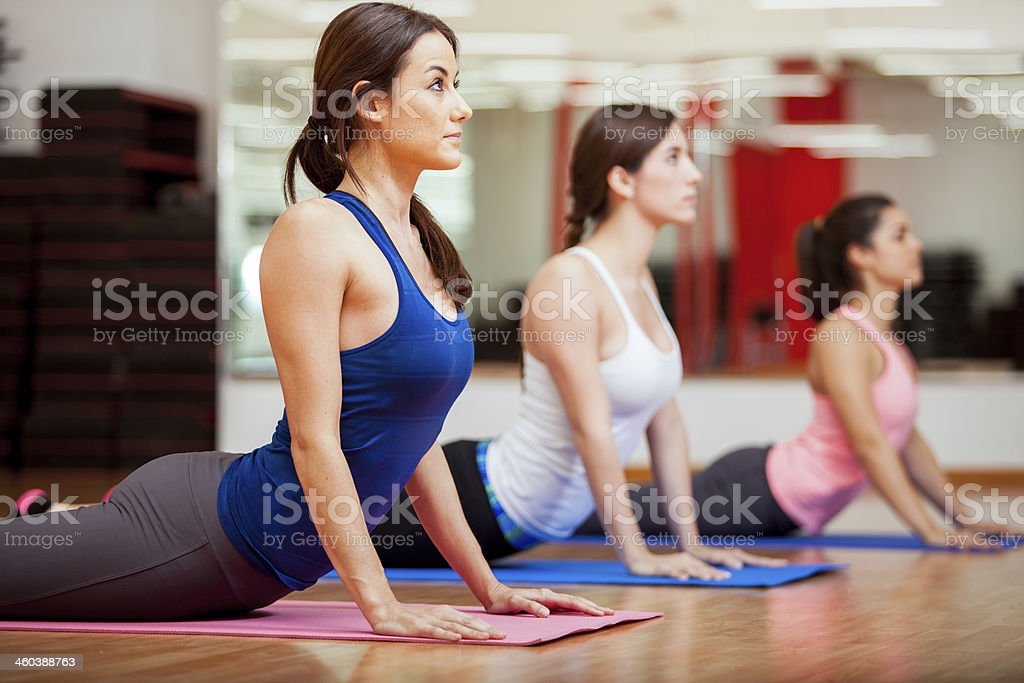 Working on the cobra yoga pose stock photo