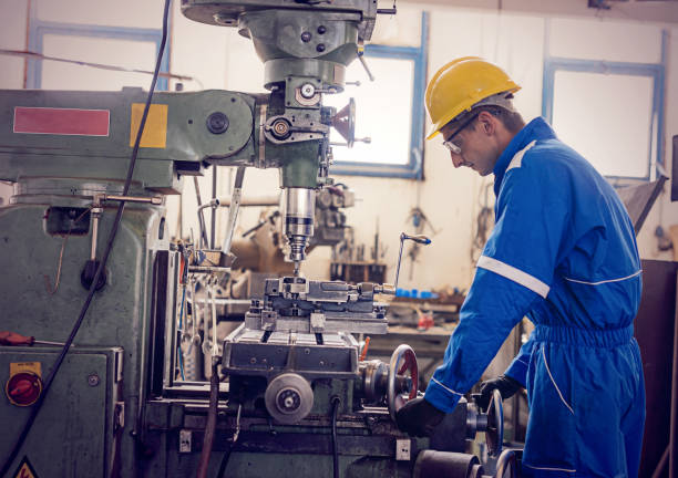 Working on the drill in factory stock photo