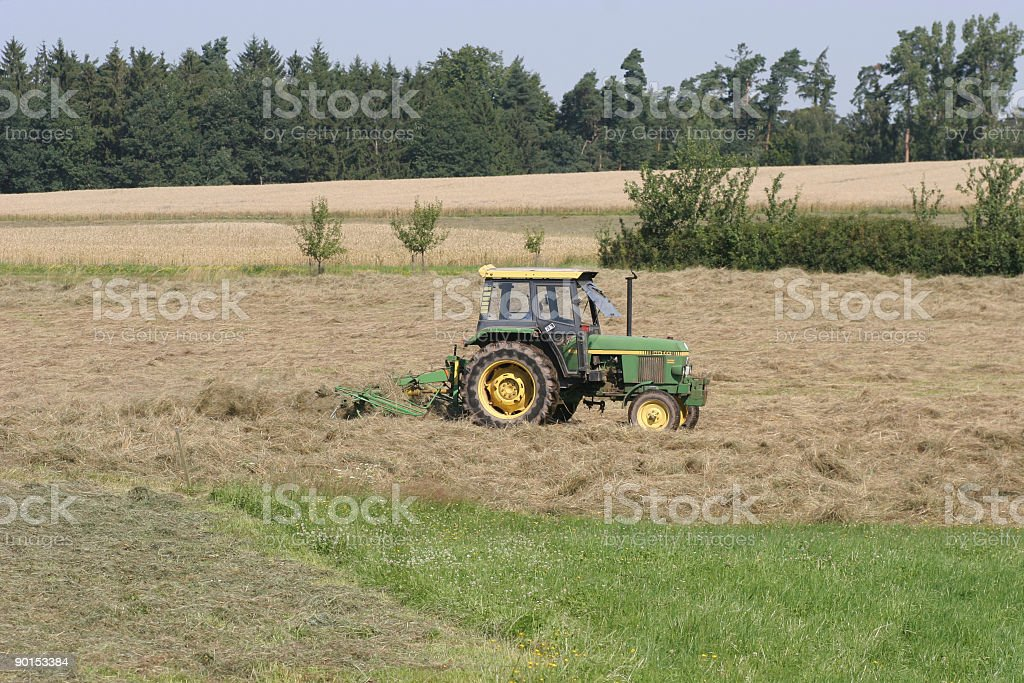 Working on the fields royalty-free stock photo