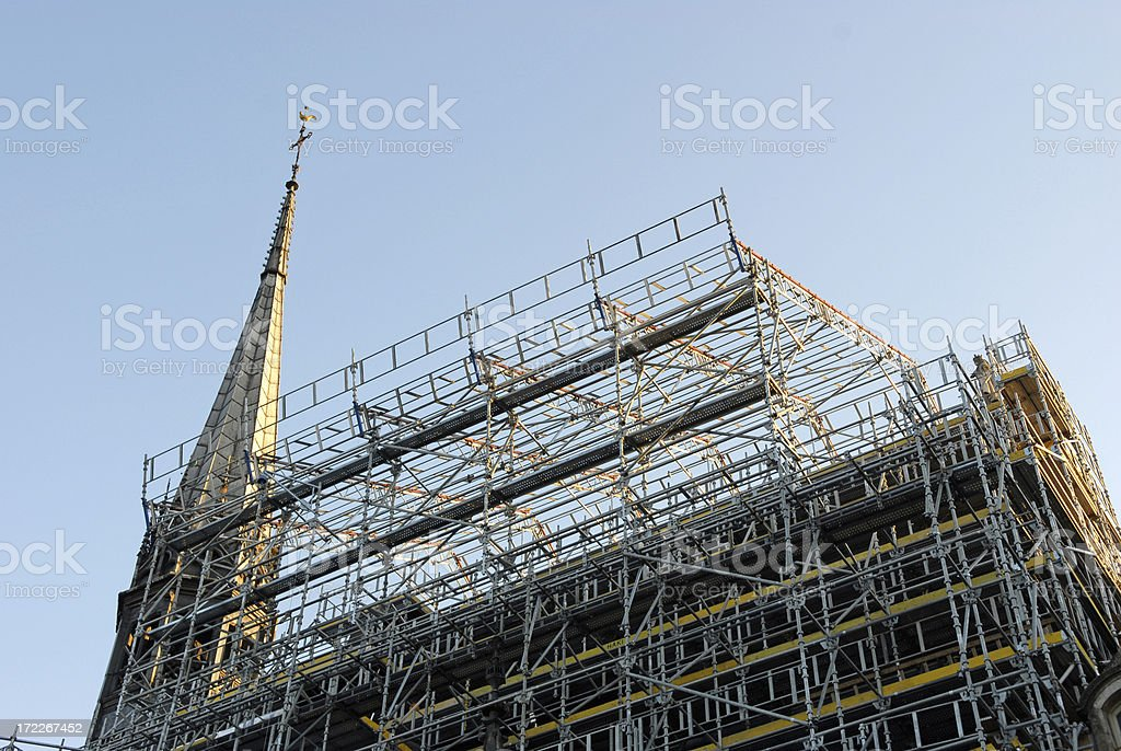 Working on the hospice  roof  , Beaune, France royalty-free stock photo