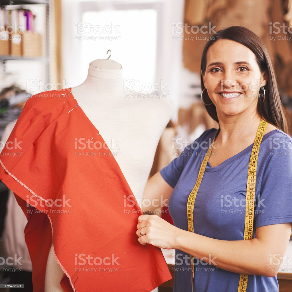 Working on the mannequin at a small business. stock photo