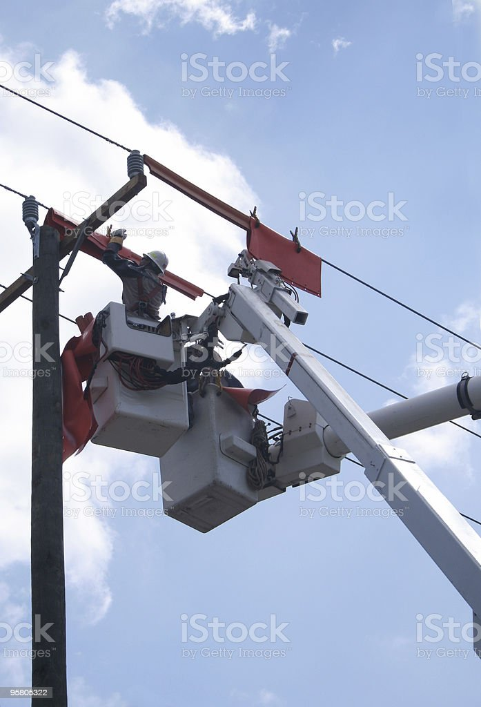Working on the Power Lines royalty-free stock photo