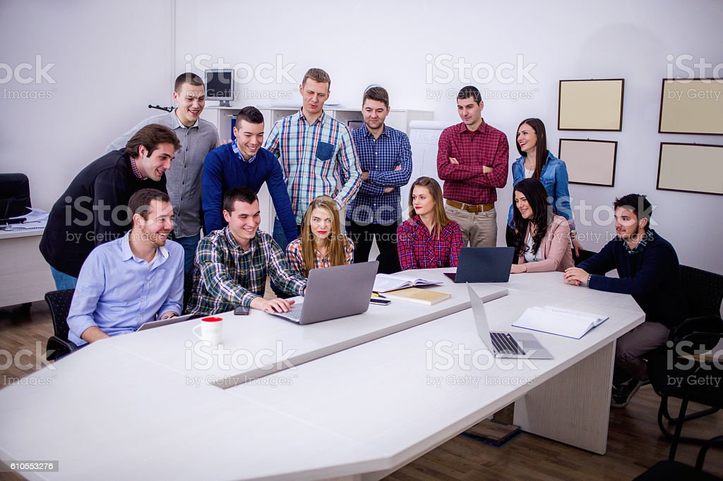 Group of college students studying together in the IT center