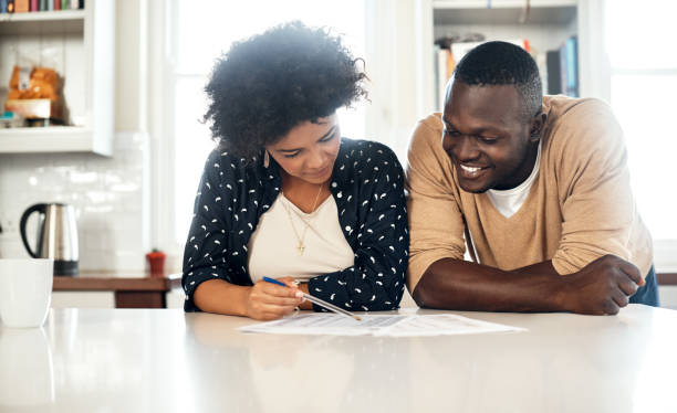 Working on their monthly expenses together stock photo