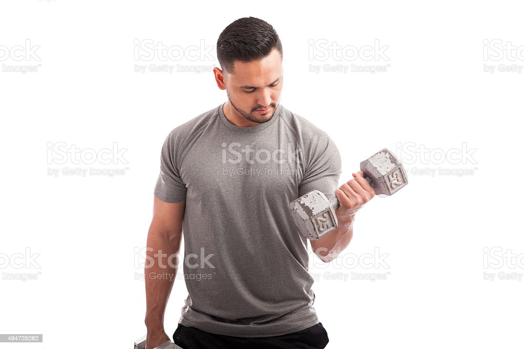 Working on those biceps stock photo