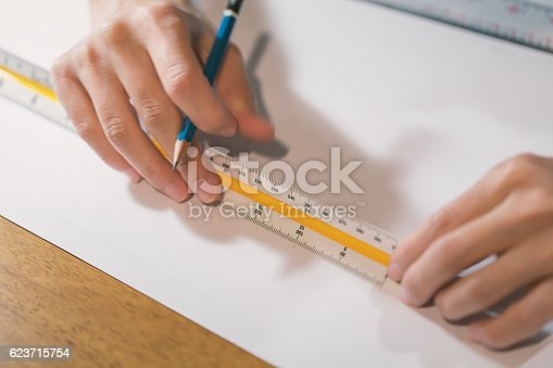 istock Working on white paper 623715754
