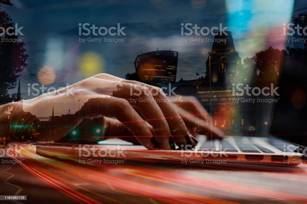 Working online on laptop, closeup of hands, checking email