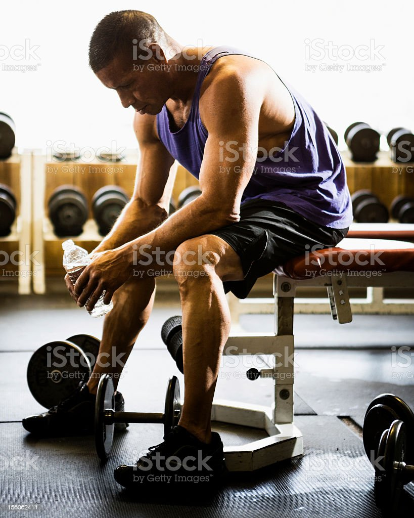 Working Out and Resting With Free Weights royalty-free stock photo