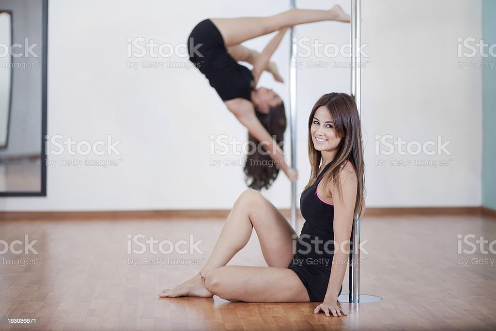 Working out in pole fitness class stock photo