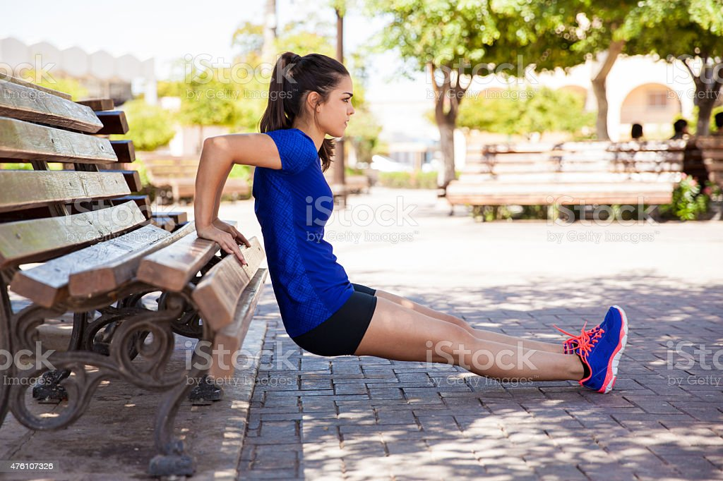 Working out on a park bench stock photo