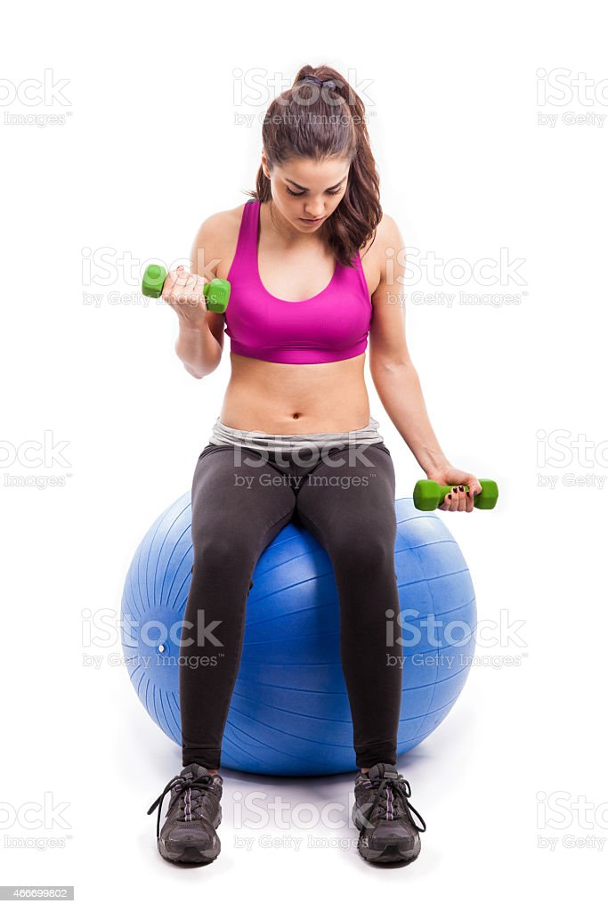 Working out on stability ball stock photo