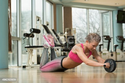 istock Working Out With Ab Roller 496263939