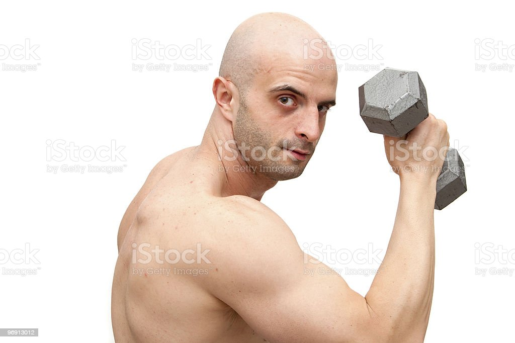 Working out with dumbbell royalty-free stock photo