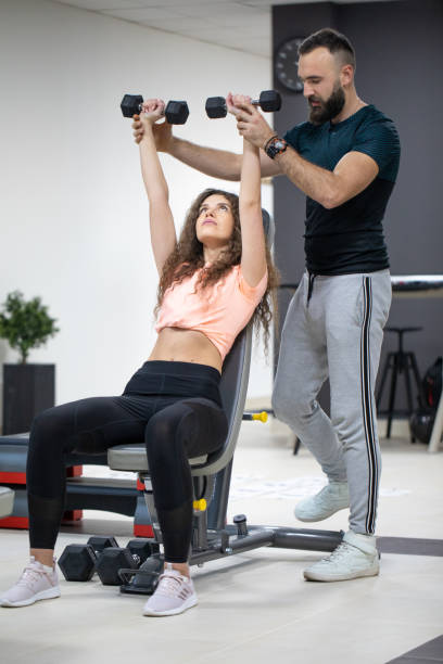 Working out with instructor stock photo