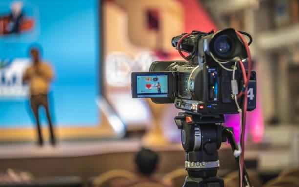 working photos - videocamera foto e immagini stock