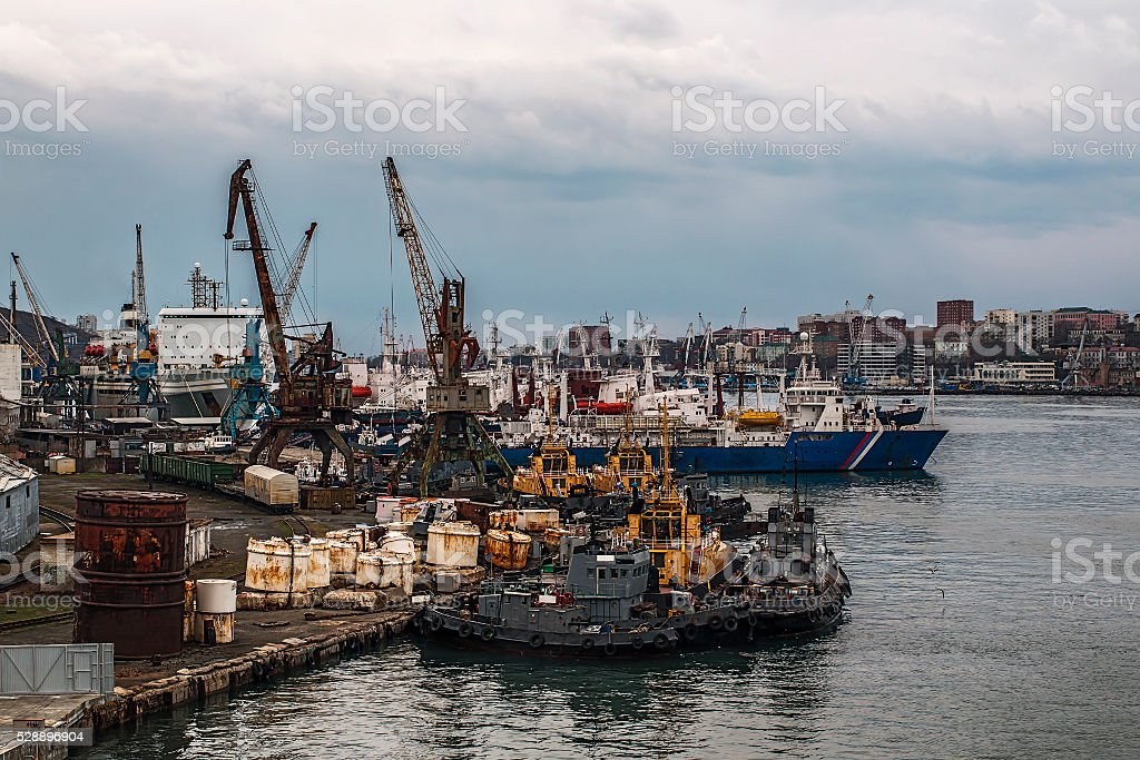 working pier in Vladivostok with moored ships stock photo