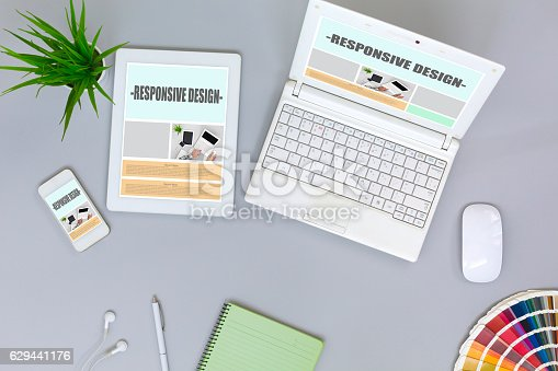 istock Working Place of web Designer on grey Table top View 629441176