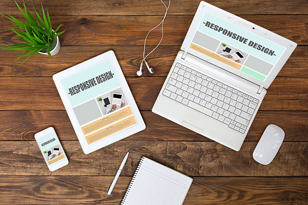 Working Place of web Designer on wood Table top View stock photo