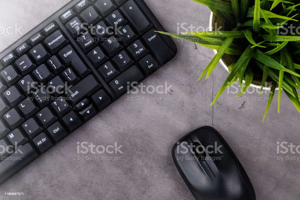 Working place on dark table with copy space. Table with keyboard,...