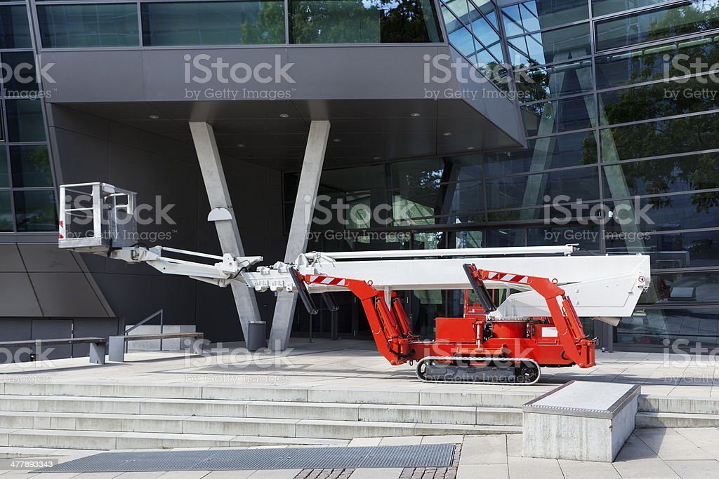 Working platform/man lift in front of an office building royalty-free stock photo