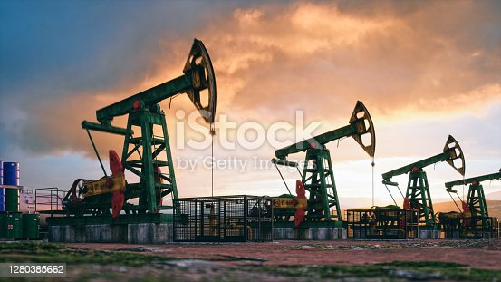Working oil pumps against a sunset sky.