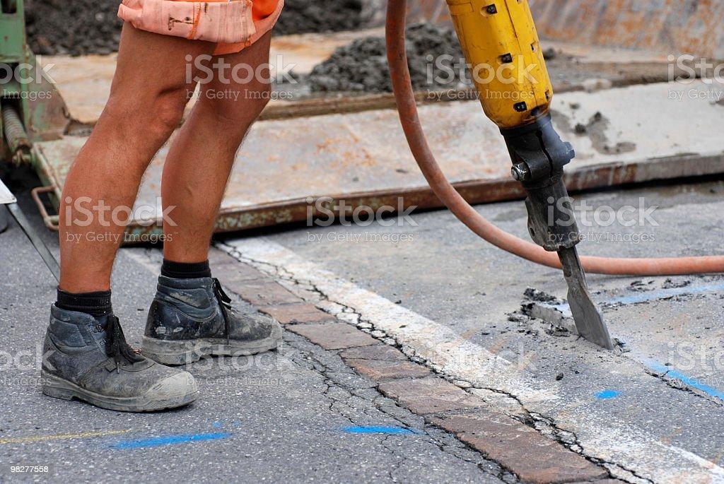 working roadman and jackhammer at roadworks royalty-free stock photo