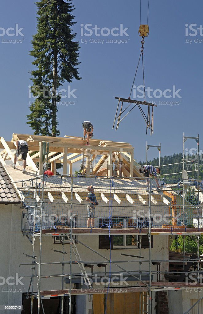 Working roofers royalty-free stock photo