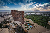 Las Vegas, Nevada, USA - May 5, 2014: Working round-the-clock modern Vegas hotels and casinos Wynn and Encore at sunrise aerial view scene in Las Vegas, Nevada on May 5, 2014.