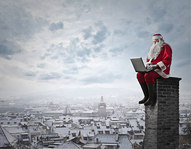 working santa - santa claus stock photos and pictures