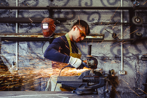 istock Working saws iron sparks 828376736