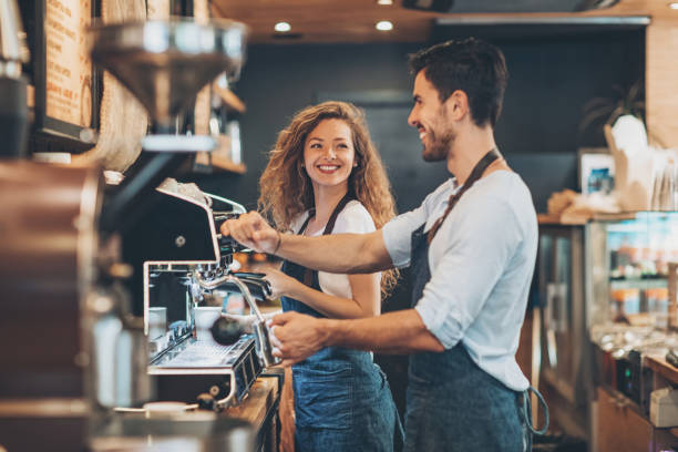 working side by side - barista stock photos and pictures