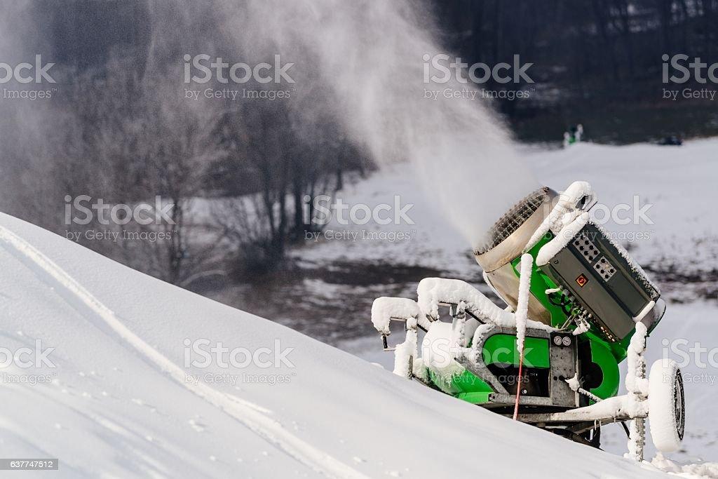Working snow cannon at ski resort. stock photo