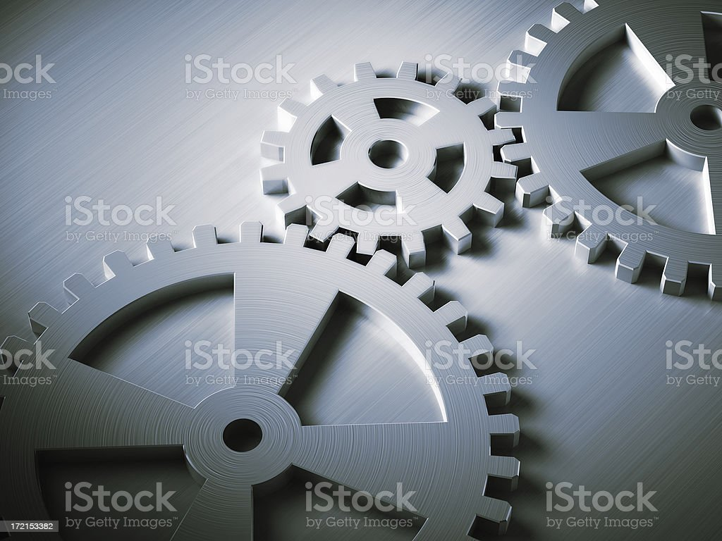 Working System Conceptual shot of 3 Cogwheels symbolizing teamwork, system or process. Art And Craft Stock Photo