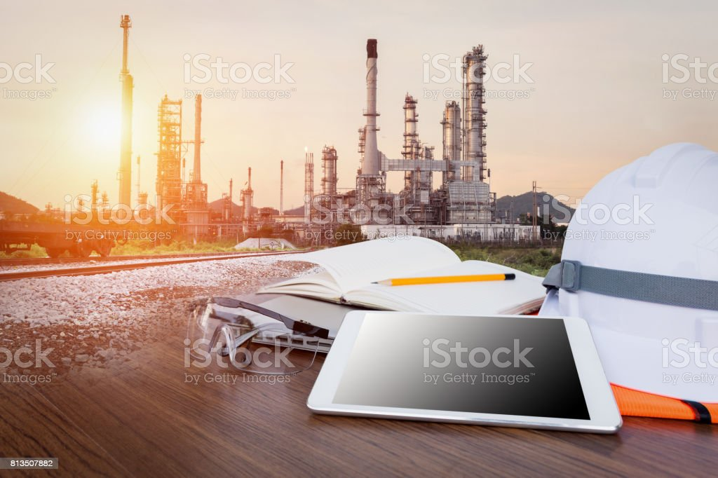 Working table engineer with tablet and tools in oil refinery industry business plant Working table engineer with tablet and tools in oil refinery industry business plant Air Pollution Stock Photo