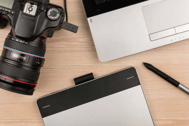 working table of photographer or artist overhead view - retouched image stock photos and pictures