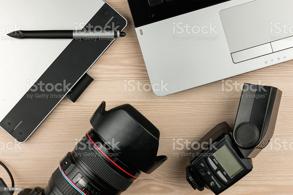 Working table photographer top view, wooden surface stock photo