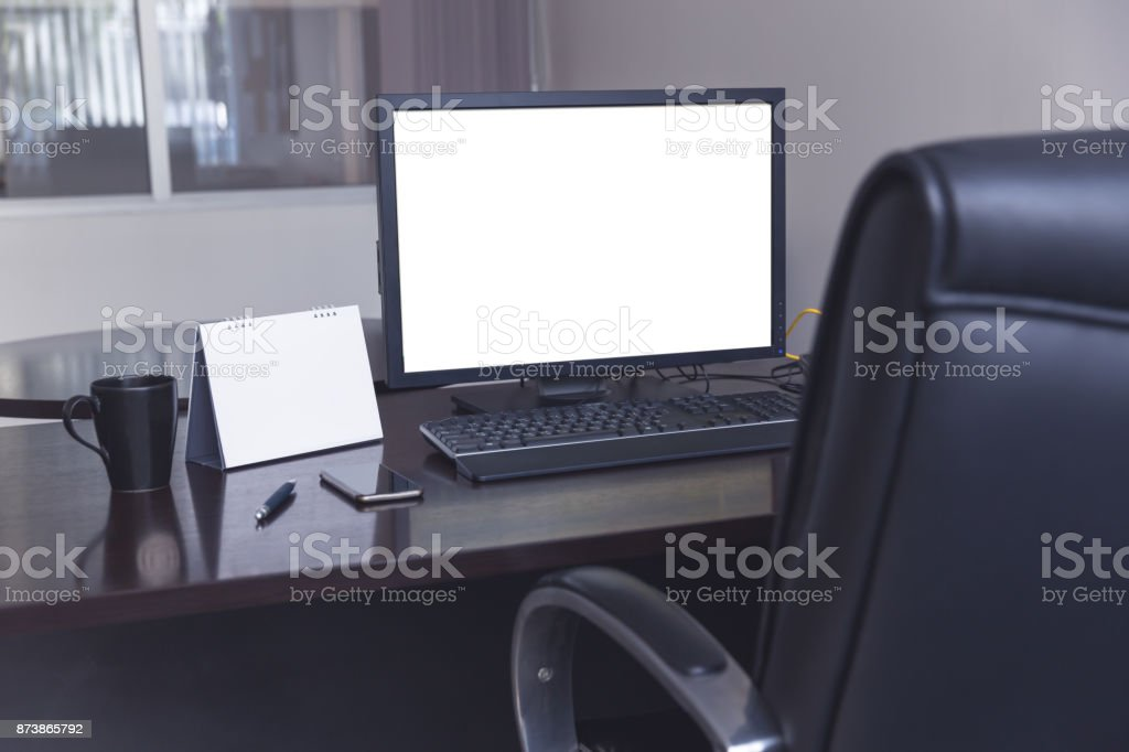 Working table with computer display and calendar with coffee cup in modern office stock photo