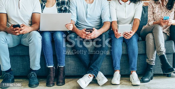 Group of young people with smart phones, digital tablets and laptop