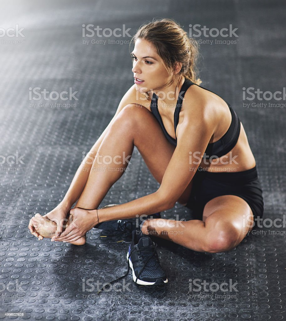 Working through her injury stock photo