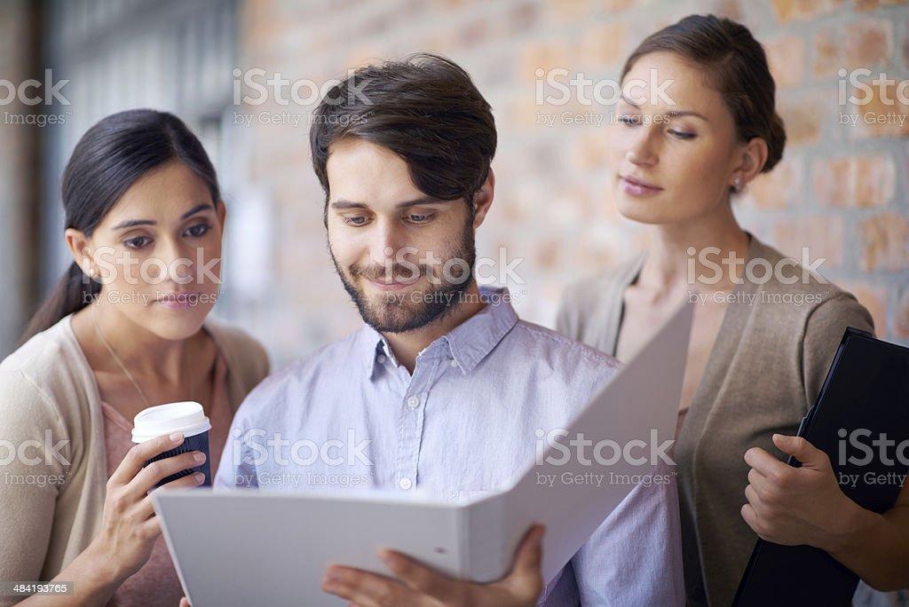 Working through their work files royalty-free stock photo